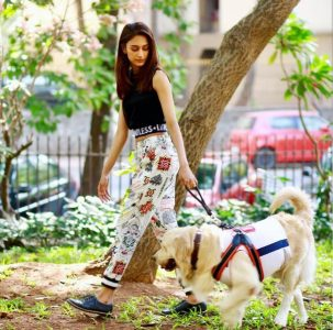 Erica Fernandes With her ped dog