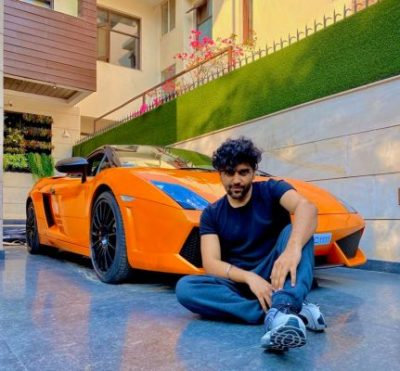 Guru Randhawa with his car Lamborghini